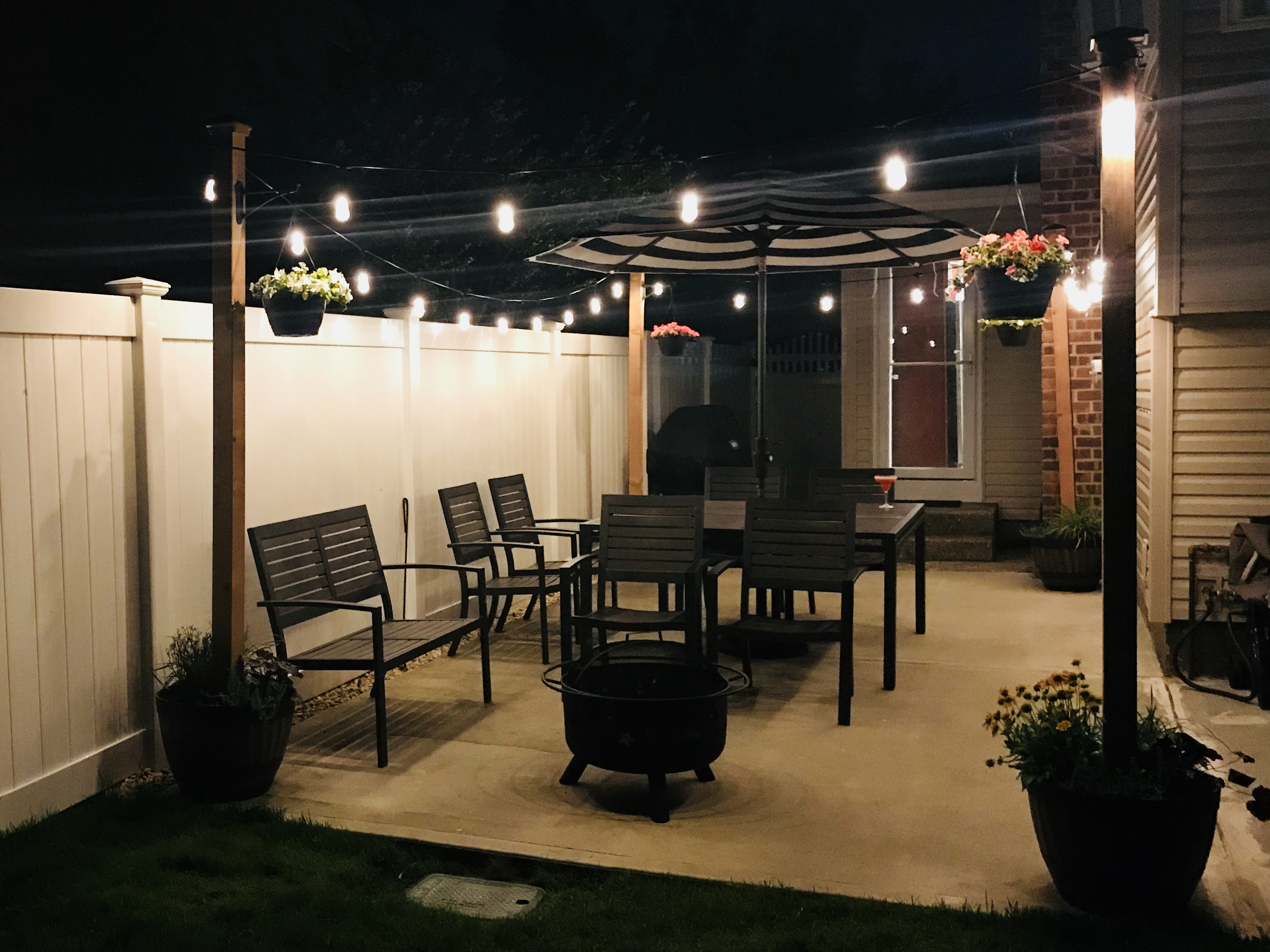 diy patio decor string lights on planter posts - Patio Decor